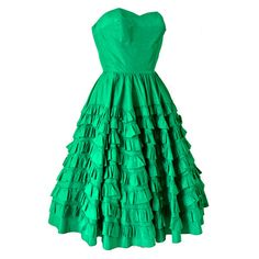 Wonderfully festive vintage 1950s petite fit party dress in vivid emerald green acetate fabric.