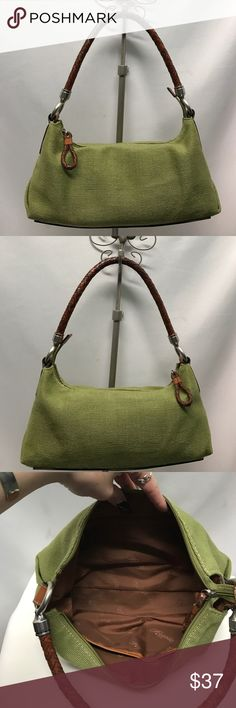 FOSSIL purse Pea green cloth fossil handbag with braided leather handle and silver hardware. Spacious interior. No stains. All hardware in great condition! Fossil Bags
