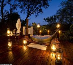 Soak under the stars: The 'star bath' at the Sanctuary Baines' Camp in Botswana is the ultimate bubble bath experience... but it will set guests back £936 per night