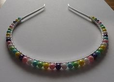 Check out this item in my Etsy shop https://www.etsy.com/uk/listing/205450419/multi-coloured-bead-tiara