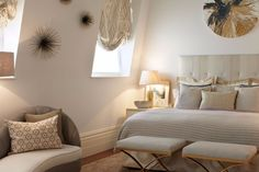 Charming cream bedroom design with a couple of bedroom benches and amazing wall fixtures.