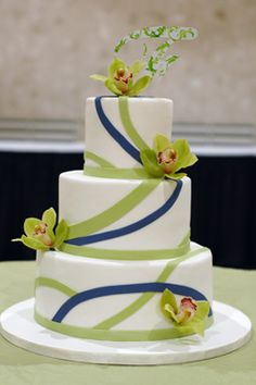 Danielle's Wedding Cake Distinct fondant stripes make a bold statement on this navy and lime wedding cake. Fresh orchids and their unique topper pull it all together. - http://apieceocake.com/gallery/album/wedding/page10#