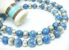 Southwestern style sterling silver 8 mm beads, notice how each bead is stamped with a southwestern design. This necklace is made of Denim Lapis 8mm gemstone round beads, sterling silver smooth round 6