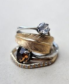 Google Image Result for http://1.bp.blogspot.com/_GekcR1q62HY/SlC9yFXiRrI/AAAAAAAAAnM/V3q-tDPCSP0/s400/feather-stacked-rings-0a.jpg