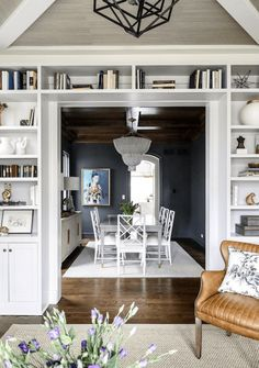 These bookshelves are a great transition from our clients' cocktail room to their dining room! The post These bookshelves are a great transition from our clients' cocktail room to thei& appeared first on Decor by Joe Rivas. Built In Bookcase, Bookcases, Styling Bookshelves, Bookshelf Ideas, Dining Lighting, Dining Room Design, Doorway, Open Shelving, Built Ins