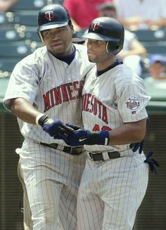 f2b210d8cae Torii Hunter congratulates David Ortiz after Ortiz slapped a homer for the  Minnesota Twins in 2002