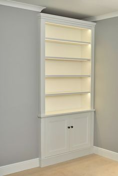 Dimmable shelf lights on this traditional alcove cabinet. Alcove Storage Living Room, Living Room Cupboards, Built In Shelves Living Room, Bedroom Cabinets, Living Room With Fireplace, New Living Room, Alcove Ideas Bedroom, Alcove Bookshelves, Alcove Shelving