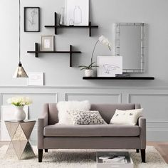 How To Decorate A Large Living Room Wall-the-spectacular-single-sofa-with-smart-black-shelf-as-a-decoration-living-room-wall-decor-ideas