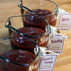 Homemade bbq sauces in little jars tied with wedding color cloth and rafia could make cute favors for the backyard bbq wedding
