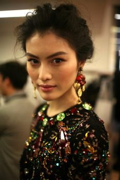 glamour:    A jeweled look, backstage at Dolce & Gabbana. Photo: Fairchild Archive
