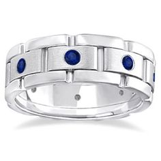 Whether you wear it as a wedding ring or as a birthstone ring, this 14-karat white gold ring studded with blue sapphires will be sure to stand out. This ring features a contemporary burnish setting fo
