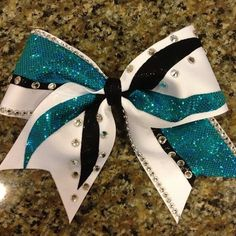 Rock star cheer bow blue black and white
