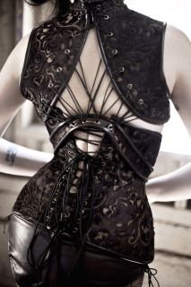 Laser cut leather underbust with fan-laced harness top.  By Anachronism in Action.