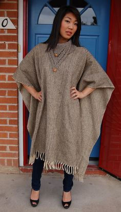 I'm going to make a poncho out of an old blanket. An ugly one that is warm.