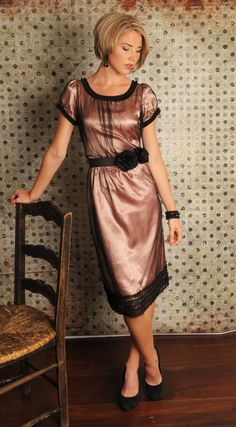 This would be a cute french looking dress.  You could change the black sheer to an ivory overlay with perhaps a raspberry colored flower at the waist.
