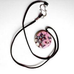 Resin Pendant Necklace Mulberry, Pink, Liliac, and White Pearl Resin Pendant on Gray Suede with Sterling Clasp, via Etsy.