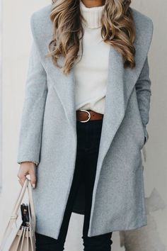 Pale blue coat, white sweater, slim black trousers