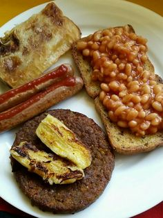 Pre-workout brunch: baked beans on megagrain toast; veggie sausages; veggie pattie w banana; (leftover) spicy veggie samosa.