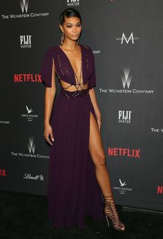 Model Chanel Iman served some serious skin in this plunging purple gown featuring a thigh high slit at the Weinstein Company and Netflix Golden Globe Party.