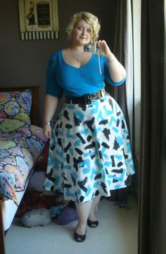 I am in LOVE with this outfit! I love the color blue and this skirt is so flirty and fun! :)