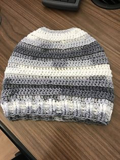 For this hat I used Lion Brand Ice Cream Crème Glacée. Color: Cookies and Cream. (I had this yarn laying around in my studio for awhile so I'm not sure if it's still being sold. It's a medium weight yarn a bit lighter than WW yarn, but I think you will do just as well with WW. I used a size G/6/4.25MM hook, but an H/8/5mm would work as well.
