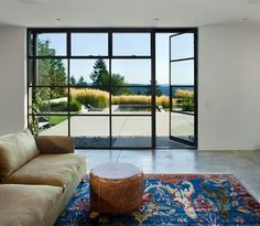 Hardscaping Steel Factory-Style Windows and Doors - Gardenista Facades with steel factory windows harken back to the greenhouses, factories, and warehouses of the century. Their elegant, nar Steel Doors And Windows, Window Company, Global Design, Iron Doors, Architectural Digest, Elle Decor, Beautiful Interiors, Outdoor Living, Interior Design