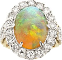 Opal, Diamond, Gold Ring, Laykin et Cie  The ring features an oval-shaped opal cabochon measuring 16.76 x 12.15 x 9.40 mm and weighing approximately 9.80 carats, enhanced by full-cut diamonds weighing a total of approximately 2.20 carats, set in 14k white and yellow gold, having a partial Laykin et Cie signature.