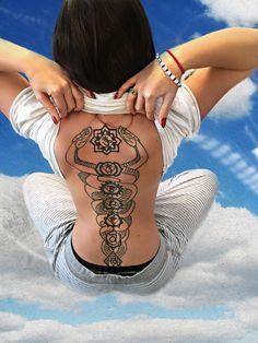Back tattoo of 7 chakras and the kundalini (ida & pingala)