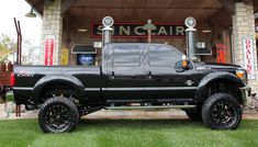 Truck yeah! The finished 2012 Ford F250 crew cab short bed. A lift kit, wheels and tires and under hood modifications took this truck from stock to super cool in less that 4 days. Photo courtesy Truck Paradise/Skip Peterson for Wheels
