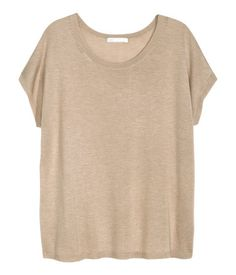 Top in a soft, fine knit with a sheen, with cap sleeves.