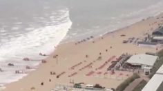 Rare tidal surge hits Dutch beaches