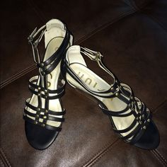 """Unisa Black Sandals Black strappy Gladiator style sandals. Gold accents, 2"""" wedge heels. Sz 8. Very comfortable. Unisa Shoes Wedges"""