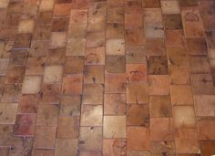 end grain wood block flooring.  i've seen this before, but not sure how it would look in a large area.