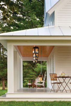 Farmhouse porch, metal roof, painted porch wood floor, porch lighting ideas, porch steps, porch swing, white house, wraparound porch.