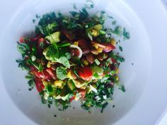 Healthy salad with avocado, corn, beans and cilantro