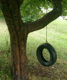 The old tire swing. We would have black feet after swinging (in our bare feet). Ours was over an old coal pile. Ahhhhh.... the good ol' days.
