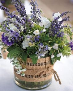 Locally grown flowers, including lavender, Queen Anne's lace, white phlox, and purple butterfly weed, add color to the festivities.