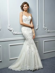 Enzoani Beautiful Collection 17-17 *Availavable at Bridal Corner Boutique in Montana Park 012 548 0078* Glamorously sexy and oh-so-alluring. This full-length mermaid gown features romantic beaded embroidered lace and Chantilly lace cascading down to an ethereal tulle skirt. A plunging sweetheart neckline with delicate spaghetti straps is perfectly sultry along with a low back featuring see-through lace panels. Delicate Chantilly hem lace and an invisible zipper complete the gorgeous look.
