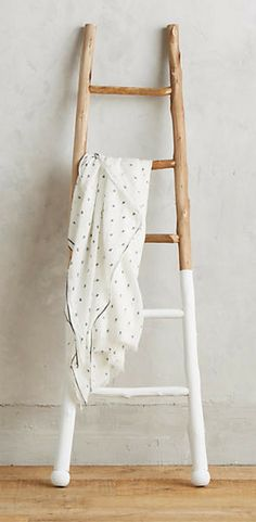 Gorgeous white-dipped ladder brings a unique flavor to farmhouse style. #afflink