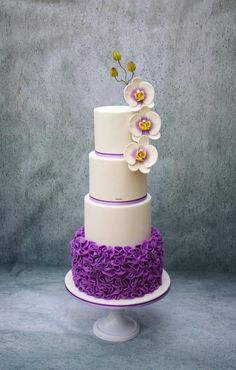 White / Purple Wedding Cake with Ruffles and Orchids by Taaartjes - http://cakesdecor.com/cakes/217971-white-purple-wedding-cake-with-ruffles-and-orchids