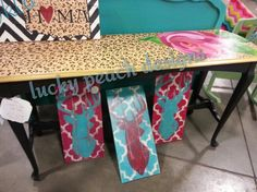 Hand painted cheetah table with rose, oklahoma sign in cheetah,  stag with quatrefoil signs.  Junk Hippy OKC, 6/15/13