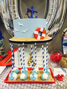What a great cake at a nautical baby shower party! See more party planning ideas at CatchMyParty.com!
