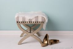 These textured antique-style tacks bring a sleek boudoir bench down to earth. They're the final step on a project like this one—try using a fabric marker and a ruler to mark placement before hammering.