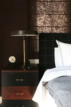 loving the mix of textures with the metallic wall, fabric headboard + an oak side table