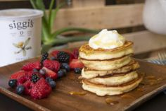 fluffy yogurt pancakes made with vanilla yogurt and topped with extra for the perfect stack you'll want for breakfast. What's For Breakfast, Perfect Breakfast, Breakfast Recipes, Vanilla Pancakes, Yogurt Pancakes, Siggis Yogurt, Vanilla Yogurt, Nordic Diet