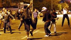 After Violent Protest, Israel To Pull Some Diplomatic Staff From Turkey -- Demonstrators throw stones at the Israeli Embassy in Ankara, as they protest against Israel's military action in Gaza, on July 18, 2014. (ph...