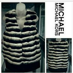"Michael Kors Faux fur vest NWT Stunning Michael Kors chinchilla pile faux fur vest! This gorgeous vest features soft faux fur in colors of white, gray&black. Stripes run horizontal. Faux leather trims the bottom of vest adding a bit of edge to this chic faux fur vest!  Pockets. Material faux fur 78% modaacrylic, 22%acrylic Faux leather 100% polyester 5 hook closure Fully lined Length approx 28"" Bust pit to pit approx 22.5"" New with tag attached Michael Kors Jackets & Coats Vests"