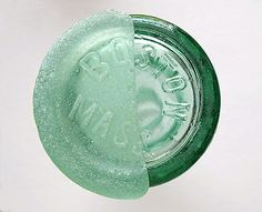 Seamaiden, New England: This wonderful Coca-cola seaglass half-bottom was found on a favorite New England beach. It is photographed perched upon the bottom of a whole Boston Coke bottle as part of a 'Before and After' seaglass photo project.