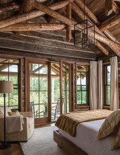 Big Sky Journal - Exposed beams,full length windows and easy access to a deck transform this bedroominto a cabin-like aerie that makes the most of indoor-outdoor living.