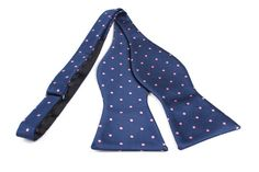 Bow Tie Untied by OTAA - The design is a dark navy blue fabric spread equally across with light pink dots resulting in an eye catching combination. The deep contrast between the two colours act as a harmonious match that is a must for any wardrobe. Purchase Bow Ties from www.otaa.com.au | Shipping World Wide  | Only $20 AUD